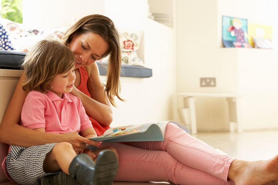 young mom reading something to her child