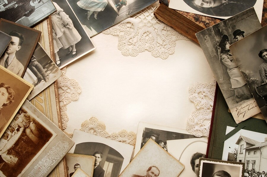 white piece of cloth surrounded by old pictures