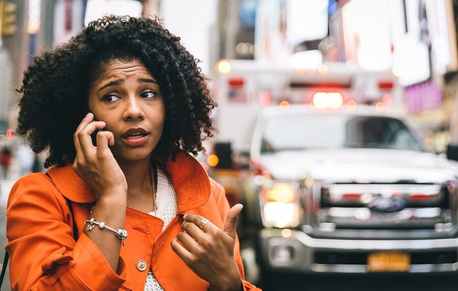 woman talking on the phone and looking worried