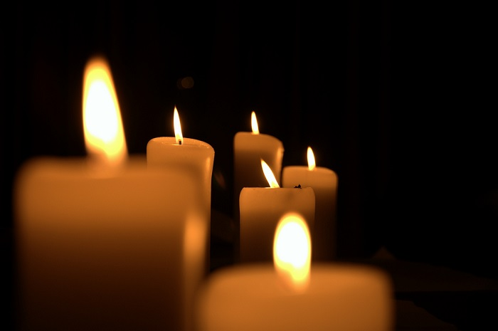 white candles on a black background