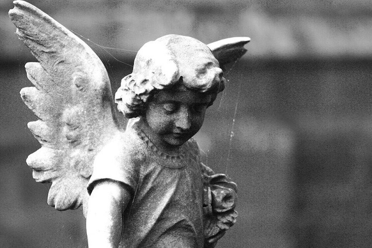 a small angel statue