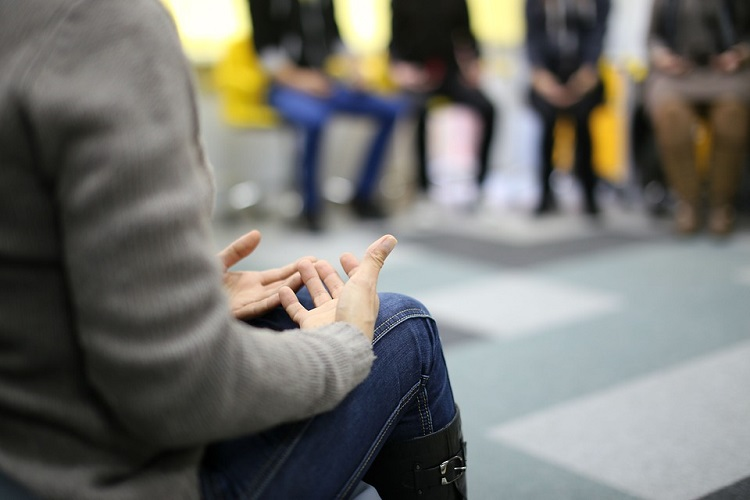 a woman in a group therapy session
