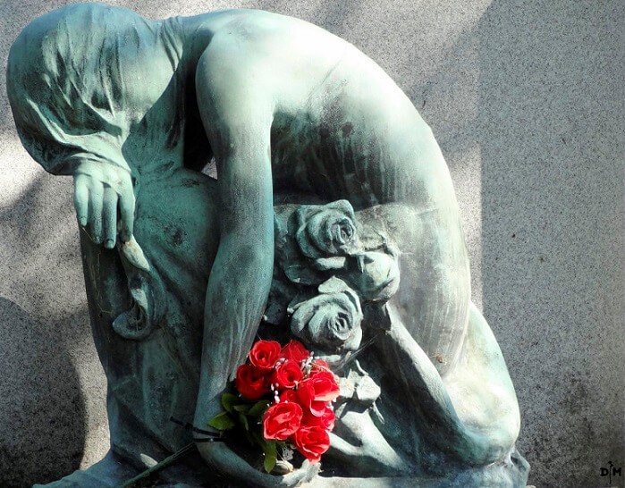 a statue representing depression and sadness
