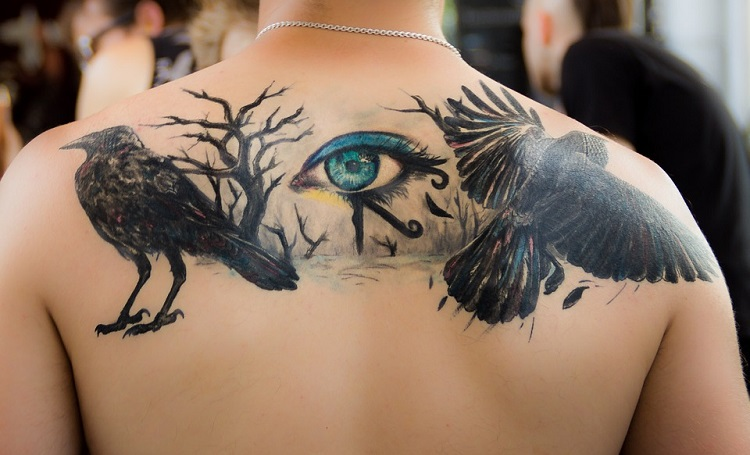 a large and beautiful gothic tattoo on the back