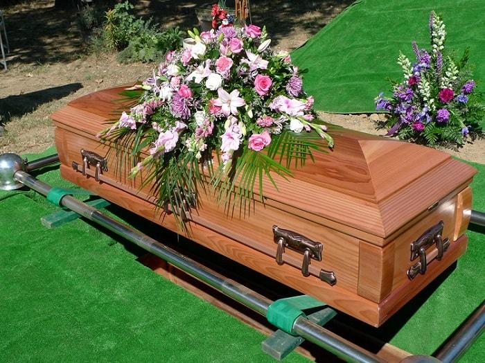 beautiful flower arrangement on coffin