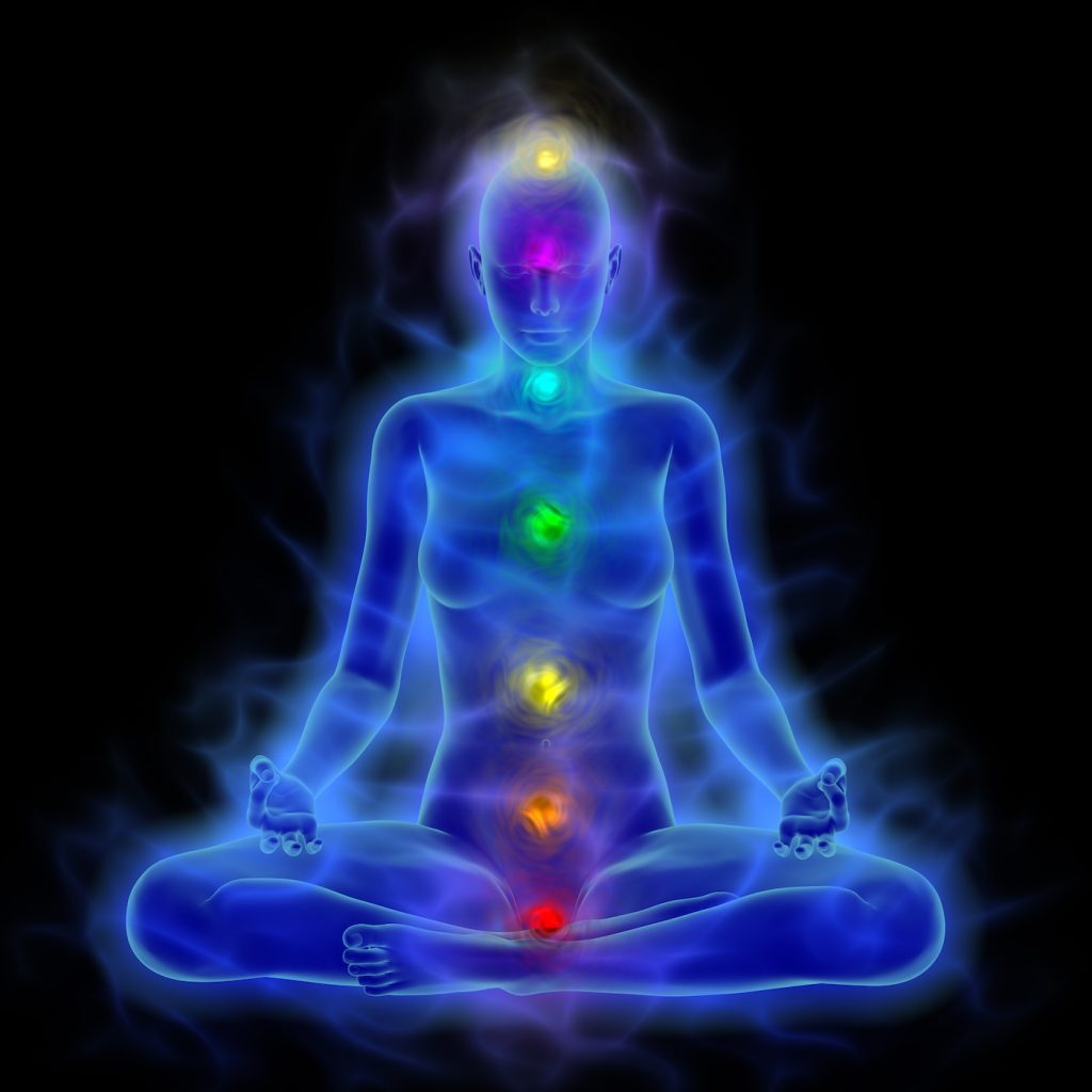 Illustration of human energy body, aura, chakra in meditation