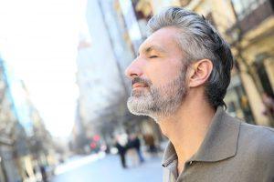 Portrait of serene mature man in town