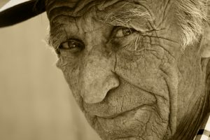 Face of the old person, in wrinkles.
